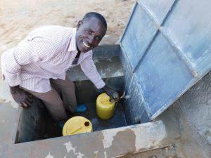 The Water Project:  Anthony Mulevu School Watchman Collecting Water