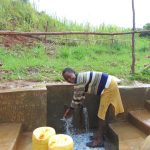 The Water Project: Musiachi Community, Mutuli Spring -  Enjoying Spring Water