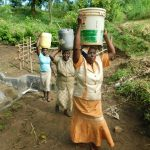 The Water Project: Rosterman Community, Lishenga Spring -  Bringing Clean Water Home