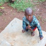 The Water Project: Imusutsu Community, Ikosangwa Spring -  Child Poses With Sanitation Platform