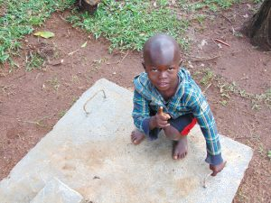 The Water Project:  Child Poses With Sanitation Platform