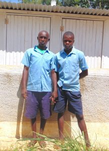 The Water Project:  Boys Stand Proudly With Latrines