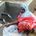 The Water Project: Namarambi Community, Iddi Spring -  Enjoying Spring Water
