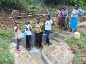 The Water Project:  Women Pose With The Spring