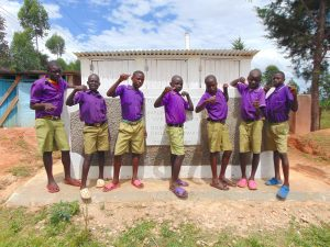 The Water Project:  Boys Pose With Latrines