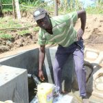 The Water Project: Kalenda B Community, Lumbasi Spring -  Easy Fetching Water