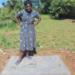 The Water Project: Emurumba Community, Makokha Spring -  New Latrine Slab Owner