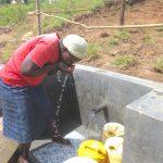 The Water Project: Kalenda A Community, Webo Simali Spring -  Enjoying A Fresh Drink
