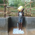 The Water Project: Kitulu Community, Kiduve Spring -  Ready To Bring Clean Water Home