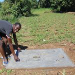 The Water Project: Emurumba Community, Makokha Spring -  Showing Off Latrine Slab Portability