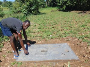 The Water Project:  Showing Off Latrine Slab Portability