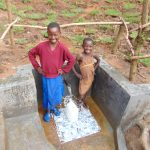 The Water Project: Maondo Community, Ambundo Spring -  Girls Pose With The Spring