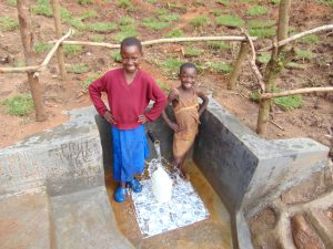 The Water Project:  Girls Pose With The Spring