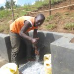 The Water Project: Kalenda A Community, Webo Simali Spring -  Thumbs Up For Clean Water