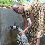 The Water Project: Kalenda B Community, Lumbasi Spring -  Enjoying The Spring Water