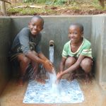 The Water Project: Kitulu Community, Kiduve Spring -  Enjoying Spring Water