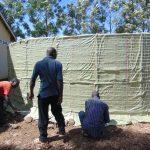 The Water Project: Friends School Ikoli Secondary -  Tying Sugar Sacks To Wire