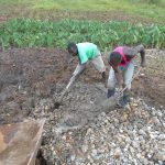 The Water Project: Kalenda A Community, Webo Simali Spring -  Mixing Concrete