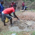 The Water Project: Mubinga Community, Mulutondo Spring -  Mixing Concrete