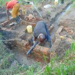 The Water Project: Bukhaywa Community, Shidero Spring -  Pipe Setting
