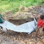 The Water Project: Emurumba Community, Makokha Spring -  Adding Tarp To Foundation