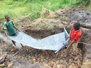 The Water Project:  Adding Tarp To Foundation