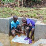The Water Project: Mubinga Community, Mulutondo Spring -  Enjoying A Fresh Drink