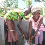 The Water Project: Kalenda B Community, Lumbasi Spring -  Girls Smile At The Spring
