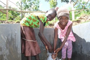 The Water Project:  Girls Smile At The Spring