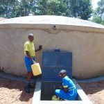 The Water Project: Saride Primary School -  Pupils Fetching Water From The Tank