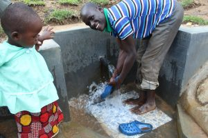 The Water Project:  Rinsing Off Shoes
