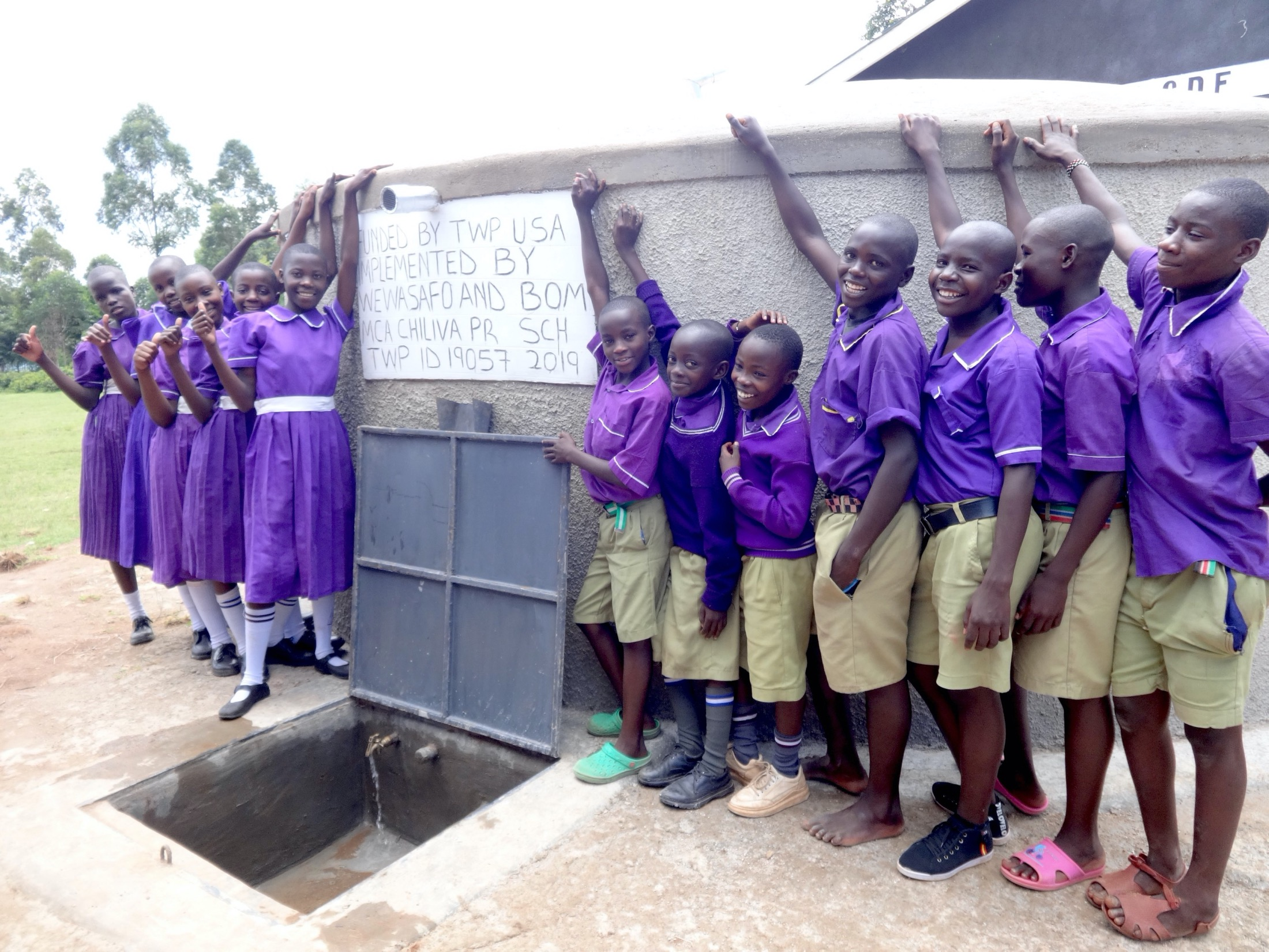 The Water Project : 53-kenya19057-students-pose-with-rain-tank