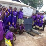 The Water Project: Chiliva Primary School -  Students And Staff Pose With Tank