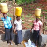 The Water Project: Maondo Community, Ambundo Spring -  Women Ready To Carry Clean Water Home