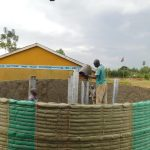 The Water Project: Sawawa Secondary School -  Filling Pillars With Concrete