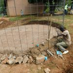 The Water Project: Hobunaka Primary School -  Fitting Wire Skeleton To Foundation