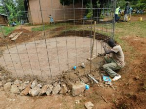 The Water Project:  Fitting Wire Skeleton To Foundation