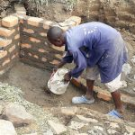 The Water Project: Mwichina Community, Matanyi Spring -  Cementing The Floor