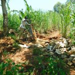 The Water Project: Namarambi Community, Iddi Spring -  Community Member Delivering Materials