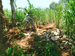 The Water Project:  Community Member Delivering Materials