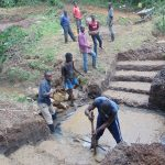 The Water Project: Mubinga Community, Mulutondo Spring -  Community Helps With Foundation