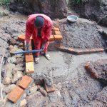 The Water Project: Maondo Community, Ambundo Spring -  Pipe Setting