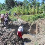 The Water Project: Kalenda B Community, Lumbasi Spring -  Community Helps Cast The Foundation
