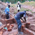 The Water Project: Kitulu Community, Kiduve Spring -  Wall Construction