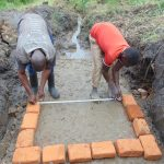 The Water Project: Emurumba Community, Makokha Spring -  Measuring Bricksetting