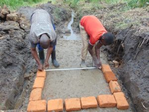 The Water Project:  Measuring Bricksetting