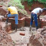 The Water Project: Imusutsu Community, Ikosangwa Spring -  Wall Construction