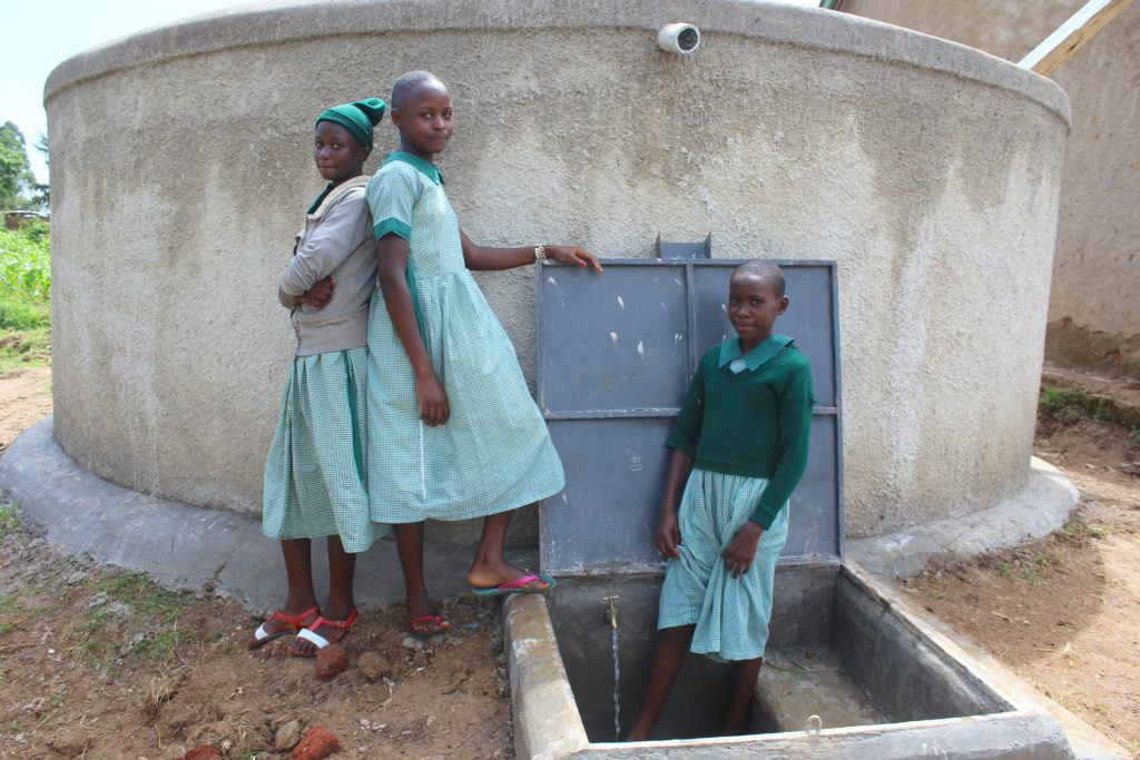 The Water Project : 64-kenya19075-girls-with-rain-tank