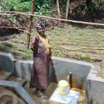The Water Project: Mubinga Community, Mulutondo Spring -  Thumbs Up For Flowing Water