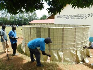 The Water Project:  Tying Sugar Sacks To Wire